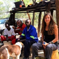 With the keepers at the chimpanzee enclosures (2015, Zambia)